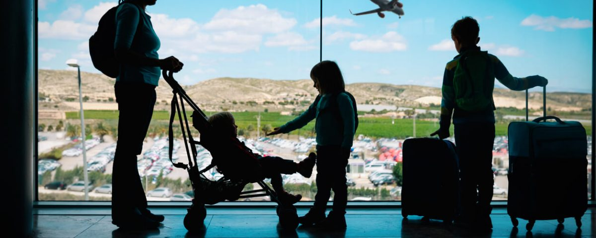 Mother in airport with children